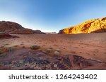 red desert wadi rum in jordan.... | Shutterstock . vector #1264243402