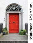 red door on a townhouse in...   Shutterstock . vector #1264256485