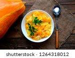 millet porridge with pumpkin in ... | Shutterstock . vector #1264318012