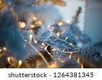 christmas tree closeup  light... | Shutterstock . vector #1264381345
