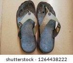 old sandal isolated on tile... | Shutterstock . vector #1264438222