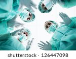 Surgeons Standing Above Of The...