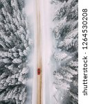 car driving on winter road.... | Shutterstock . vector #1264530208