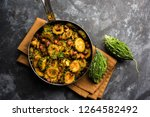 cooked bitter melon gourd or... | Shutterstock . vector #1264582492
