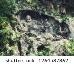 Famous Stone Sculptures of `Big Belly` Maitreya Buddha and Eighteen Lohan Monks at Lingyin Temple, Hangzhou, China. Lingyin Temple is one of the popular tourist destinations in Hangzhou.