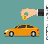 hand put dollar in car shaped... | Shutterstock .eps vector #1264638898