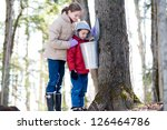 Two Children Looking In A Sap...