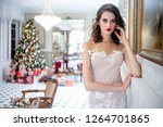 beautiful young woman in an... | Shutterstock . vector #1264701865