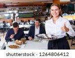 waitress in white shirt... | Shutterstock . vector #1264806412