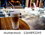 latte macchiato on a table in...   Shutterstock . vector #1264892245