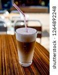latte macchiato on a table in...   Shutterstock . vector #1264892248