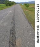 Small photo of Tyres mark on asphalt road, the vehicle has sped away.
