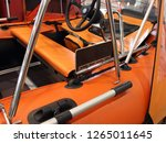 Small photo of Tuning orange inflatable PVC motor boat - steering wheel console, paddle with rowlock, seat, fishing table and bow awning