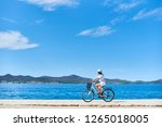girl cyclist in white summer... | Shutterstock . vector #1265018005