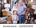 family with small daughter... | Shutterstock . vector #1265023345