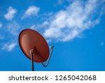 satellite tv antenna on blue... | Shutterstock . vector #1265042068