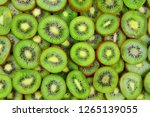 top view of heap of sliced kiwi ... | Shutterstock . vector #1265139055