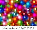 defocused ligths of christmas... | Shutterstock . vector #1265151595