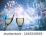 champagne glasses on sparkling... | Shutterstock . vector #1265210035