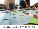 business people analyzing... | Shutterstock . vector #1265224198