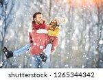 happy young couple in winter... | Shutterstock . vector #1265344342