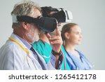 group of happy doctor surgeon... | Shutterstock . vector #1265412178