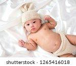 cute newborn three month baby... | Shutterstock . vector #1265416018