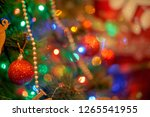 christmas tree in warm light... | Shutterstock . vector #1265541955