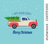 pickup truck with christmas tree | Shutterstock .eps vector #1265551042