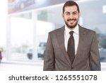 auto salesman in showroom | Shutterstock . vector #1265551078