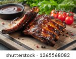 closeup of pork ribs grilled... | Shutterstock . vector #1265568082