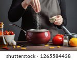 the chef preparations spaghetti ... | Shutterstock . vector #1265584438