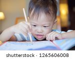 cute asian 2 years old toddler... | Shutterstock . vector #1265606008