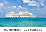 luxury cruise ship at port.... | Shutterstock . vector #1265606938