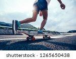skateboarder skateboarding on... | Shutterstock . vector #1265650438