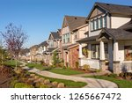 row of houses in a suburb in... | Shutterstock . vector #1265667472