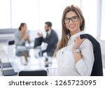 smiling business woman standing ...   Shutterstock . vector #1265723095