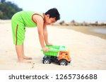 cute little boy play on beach | Shutterstock . vector #1265736688
