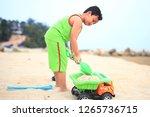 cute little boy play on beach | Shutterstock . vector #1265736715