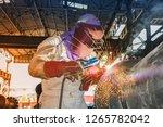 worker welding metal piping... | Shutterstock . vector #1265782042