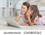 mother and daughter using... | Shutterstock . vector #1265805262