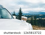 car close up with two coffee...   Shutterstock . vector #1265813722