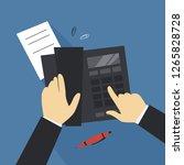 hands working with fax machine... | Shutterstock .eps vector #1265828728