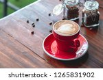 red coffee cup put on an old... | Shutterstock . vector #1265831902