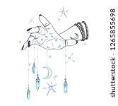 female hand with gem pendants... | Shutterstock .eps vector #1265855698