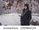 beautiful young woman outdoors... | Shutterstock . vector #1265864125