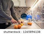 man in kitchen making juice... | Shutterstock . vector #1265896138