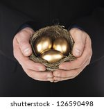 Human Hand Holding A Nest With...