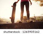 skateboarder skateboarding at... | Shutterstock . vector #1265905162
