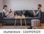 couple at home using mobile... | Shutterstock . vector #1265929225